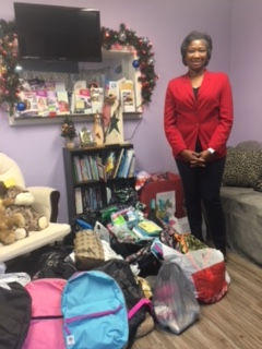 Chapter member Tina Nelson stands with donated items.